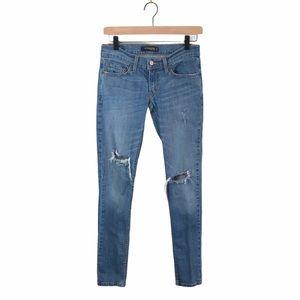Levi's Too Superlow 524 Skinny Distressed Jeans